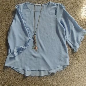 Beautiful Pastel Blue Blouse With Ruffle Detail